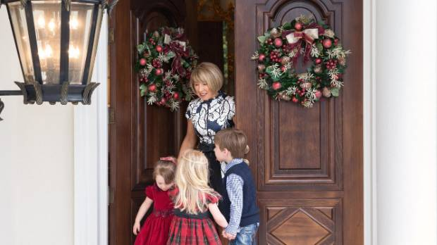 Candy meets her grandchildren at the front doors, which were copied from a photo of an apartment entrance in Paris.