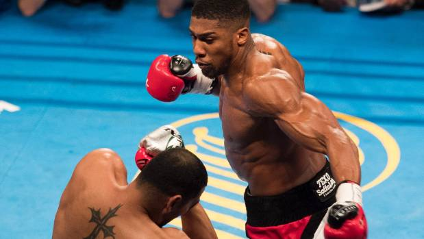 Anthony Joshua moves in to finish of American Eric Molina and retain his IBF title.
