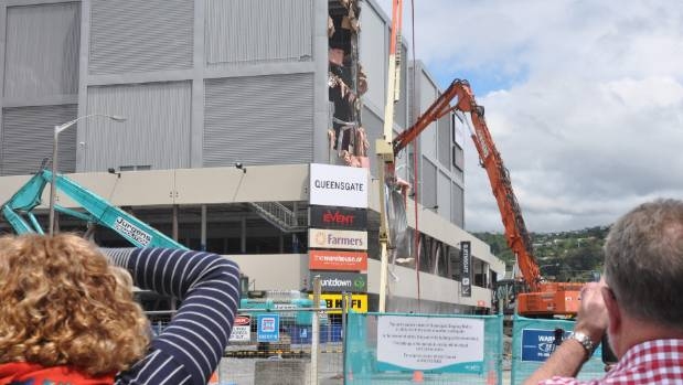 Demolition of the quake-damaged section of Lower Hutt's Queensgate Mall is on track to finish about the end of February, ...