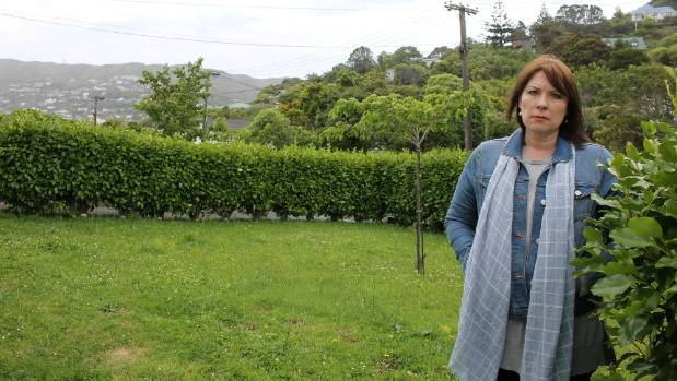 After maintaining the hedge on a berm outside her Wellington home for seven years, Andrea Skews says the council now ...