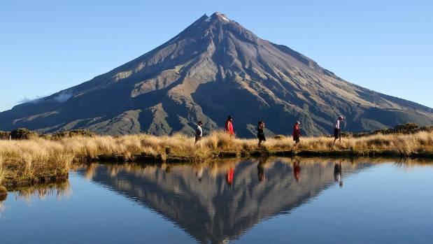 The Pouakai Circuit, with Mt Taranaki reflected in a mountain lake.