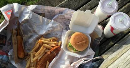 The cheeseburger, crumbed piece of snapper, hot dog, chips and a thickshake from Hamilton East's Fush and Chups.