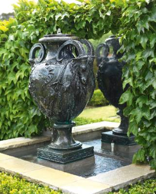 The water feature urn that sits at the end of the pergola.