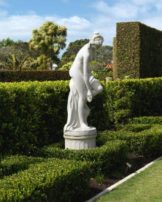 The statue at the end of the reflection pond was bought from Donald Melville Antiques in Takapuna.
