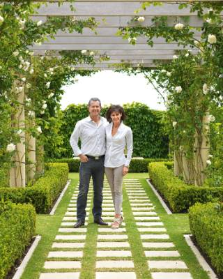 Chris and Trish under the restored pergola, planted in 'Mme Alfred Carrière' roses and stephanotis.