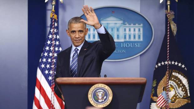 Obama waves as he leaves the podium at his last news conference of the year.