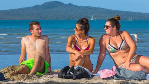 Lucas Klethi, Camille Francais and Marion Menand enjoy the sun in Auckland's Mission Bay - but they've been dismayed ...