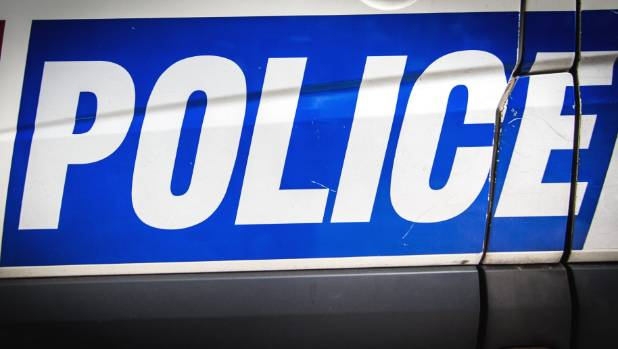 A woman escaped three men who threatened her with a weapon on Saturday night.