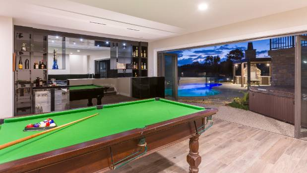 The Man Cave Nz : Poolside bar and games room create the ultimate man cave