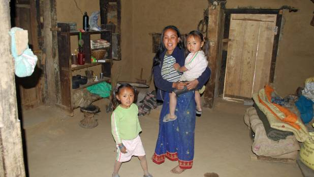 Amita and Ramita with their mother in her kitchen. They had never seen a car or a a TV, or been to Kathmandu