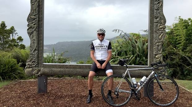 Lance Armstrong poses at the Arataki Visitor Centre in the Waitakere Ranges.