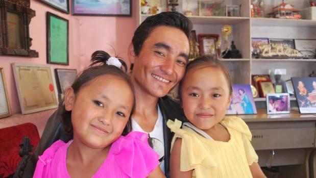 Amita and Ramita in school in Kathmandu with their father, Ujir.