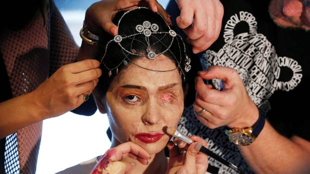 Indian model and acid attack survivor Reshma Quereshi has make up applied before walking to present Indian designer ...