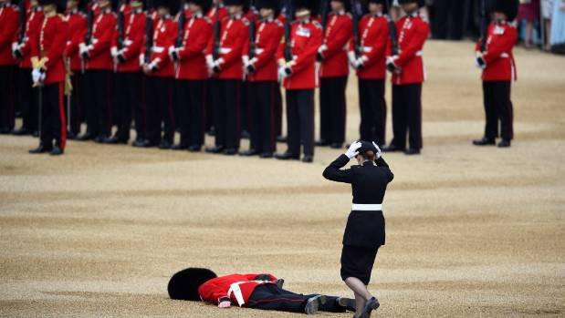 A Guardsman faints at Horseguards Parade for the annual Trooping the Colour ceremony in central London, Britain June 11, ...