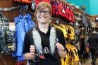 Fish City Albany sales staff Daniel Redpath demonstrates one of the lifejackets which will be discounted by $40 with a ...