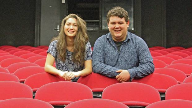 Katrina George and Christian George sit in the theatre at Birkenhead College where it all began.
