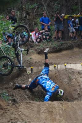 Liam Jackson takes a tumble during the third round of the Mountainbike New Zealand Cup downhill series at Kaka in Nelson.