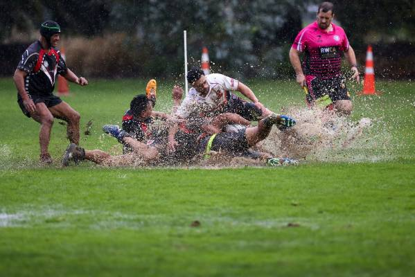 Action from the rain-soaked Tasman Rugby League game between the Tahunanui Tigers and the Wairau Taniwha.