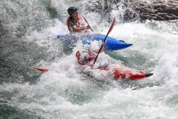 Kayakers race down the Matakitaki River on day one of the Buller Festival.