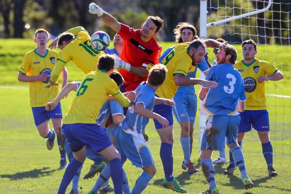 Under immense pressure from Cashmere Technical players, Nelson Suburbs goalkeeper Coey Turipa punches away the ball from ...