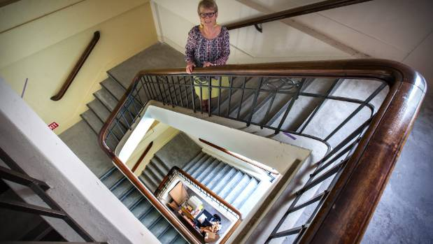 Palmerston North City Library archivist Lesly Courtney checks the staircase that is out of bounds to the public. ...