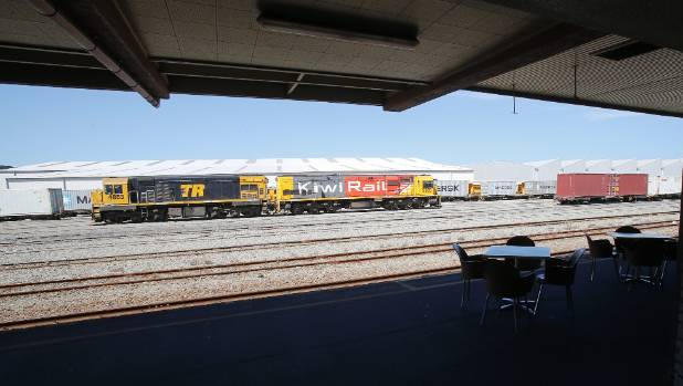 Locomotives pass the otherwise quiet Timaru Railway Station building.