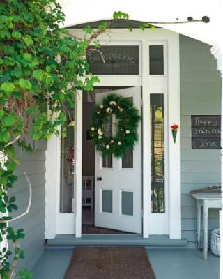The wreath on the door of Vanessa and Richard Owen's Kerikeri house goes up every Christmas.