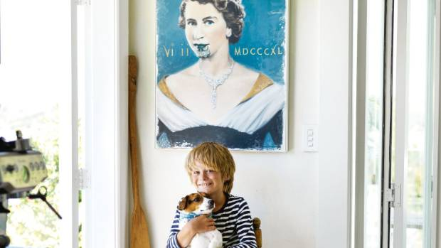 Reef and Jack Russell Archie sit under Vanessa's favourite print by Barry Ross; the Queen with a Moko.