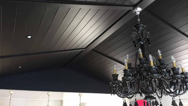 Coe's black chandelier, which hangs in the smaller living room.