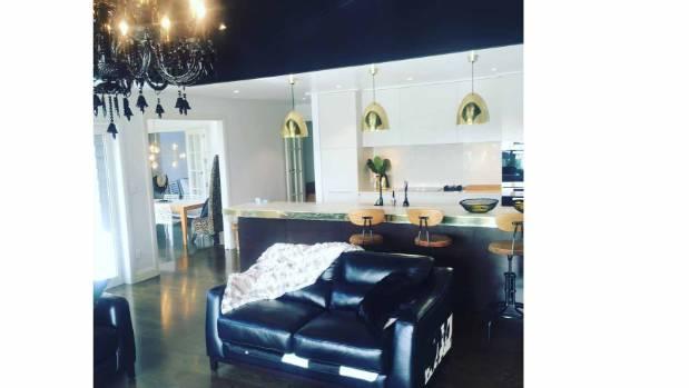 Coe's open-plan informal living room and kitchen.