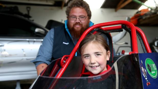 Southern Dragways Club president Steve Acker with his daughter Brooke, 9, who will be racing her new dragster at ...
