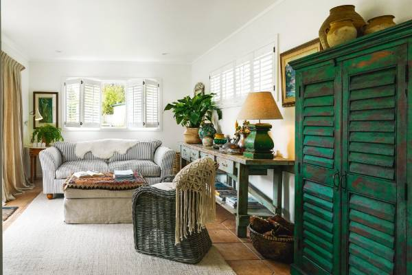 Shutters were installed throughout the house, including the rear living room tucked behind the kitchen that catches the ...