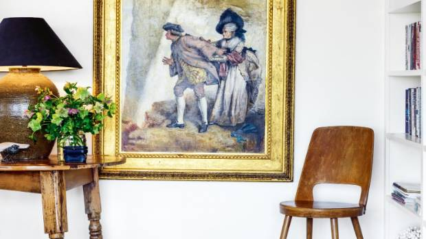 A simple wooden chair from nearby antiques store So Vintage sits alongside a beloved gilt-framed oil painting.