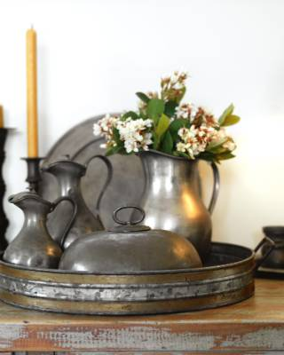 An industrial sideboard, found in Greytown, holds old pewter that has been inherited, collected or given to Louise by ...