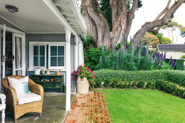 Some visitors don't make it past the front verandah of Pipi Cottage, Louise Worsp's Hawke's Bay home – it's an ideal ...