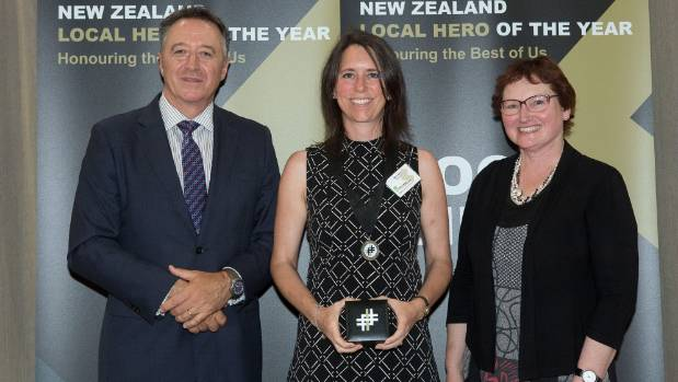 Sam Hart, centre, says she was overwhelmed when she found out she had won a 2016 Kiwibank Local Hero award.