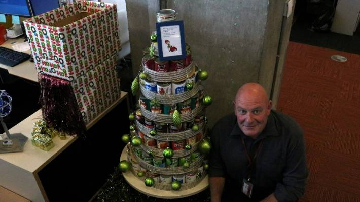 richard gant and his colleagues have created christmas trees made from cans which will be