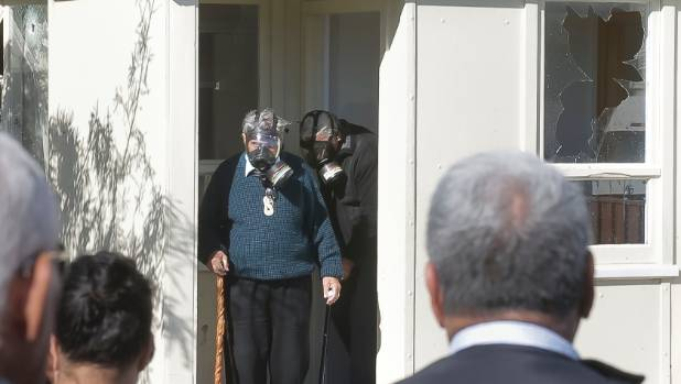 Gunman Pita Te Kira's family, friends and community members gathered outside as local kaumatua donned gas masks and went ...