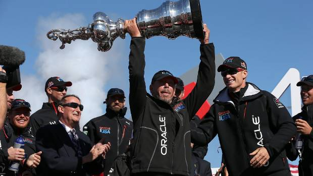 Oracle CEO Larry Ellison lifts the America's Cup in 2013 after his Team USA boat skippered by Jimmy Spithill secured ...