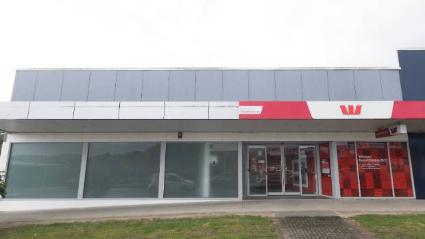 The frosted windows of this Glen Eden building used to house a full Westpac branch. It was shut over a year ago, leaving ...