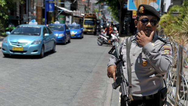 Indonesian police kill 2 militants during raid on house in Java