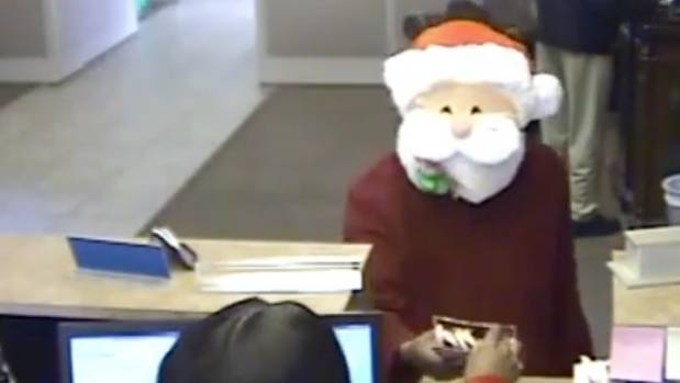 Man wearing Santa mask robs Tennessee bank