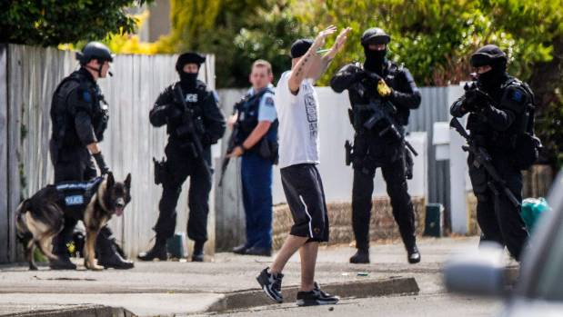 A man is arrested by armed officers on Ferguson St, Palmerston North.