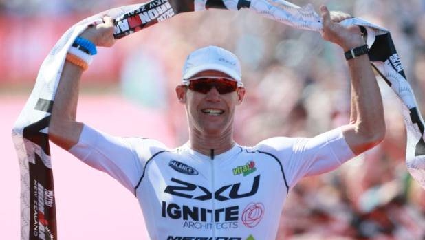 Cameron Brown celebrates winning his 12th Ironman New Zealand title in March.