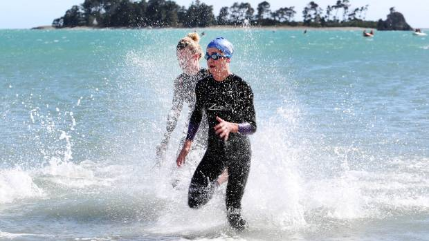 Flossie Van Dyke, right, was the first female swimmer to reach Tahunanui Beach after competing in the Eyebright Mile sea ...