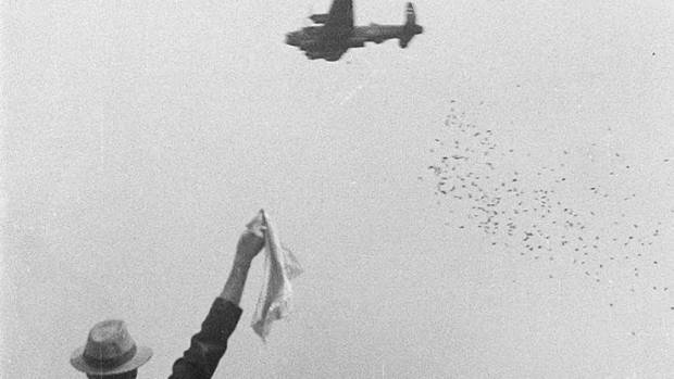 Grateful Dutch citizen waving during Operation Manna