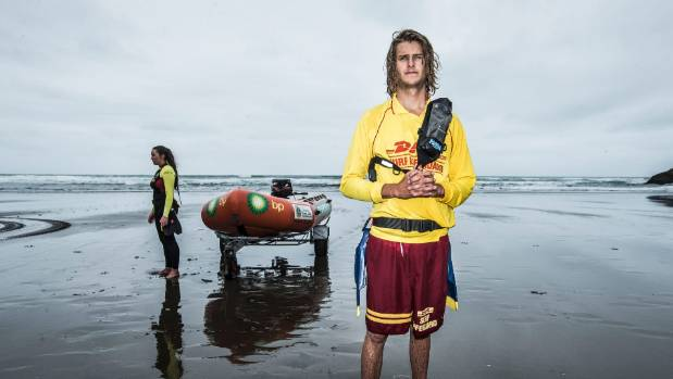 Oli Stewart and Lauren Williams (background) are surf lifesavers at Piha in Auckland.