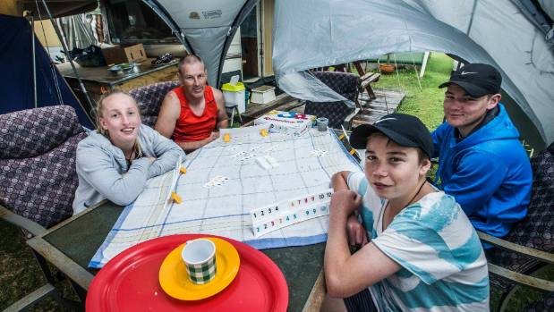 Rainy day Rummikub at Piha campground (l-r): Ella Lythe, Terry Lythe-Brown, Declan Crocker and Ethan Lythe-Brown.