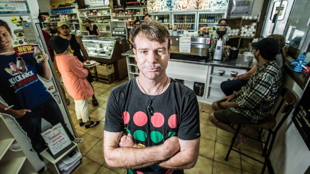 Jason Friend at the Piha Store: pies and coffee are in demand, rain or shine.
