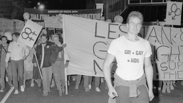 An anti-gay campaigner marches ahead of people supporting the Homosexual Law Reform Bill in Willis St, Wellington, in 1985.